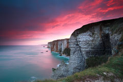 Dramatic sunrise over cliffs in Atlantic ocean. Etretat, France stock photo