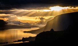 Dramatic Sunrise Over Crown Point on the Columbia River Gorge. A dramatically lit sunrise on the Columbia River with Vista House at Crown Point in the foreground Stock Image