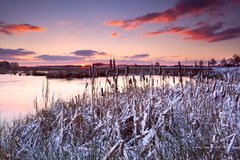 Dramatic sunrise over frozen lake Royalty Free Stock Images