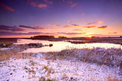 Dramatic sunrise over frozen lake Stock Image