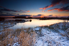 Sunrise over river in winter Stock Photos