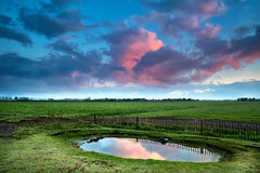 Dramatic sunrise over little pond Royalty Free Stock Images