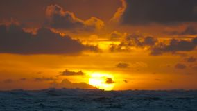 Dramatic sunrise over ocean waves. Clouds. Dramatic sunrise over ocean waves. Cloudy sky stock footage