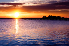 Dramatic sunrise over river. Pier. Indian river, Florida, USA Stock Images