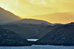 Dramatic sunrise over a rocky seashore Royalty Free Stock Photo