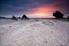 Dramatic sunrise over sand dunes Stock Photos