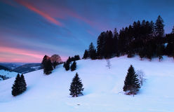Dramatic sunrise over snowy mountains Royalty Free Stock Images