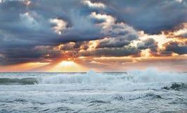 Dramatic sunrise. Dramatic sunrise over the stormy sea Stock Photography