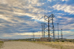 Dramatic sunrise over transmitting towers Stock Images