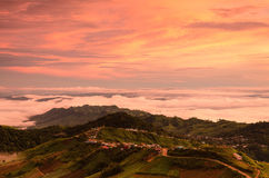 Dramatic sunrise over valley of fog Stock Image