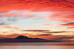 Dramatic sunrise in the sea for background. Stock Images