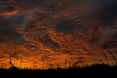 Dramatic sunrise sky at solstice in Russia. Horizontal Stock Photo