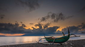 Dramatic Sunrise Time Lapse at beach with Bali Island visible from Banyuwangi, Indonesia stock video footage