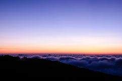 Dramatic sunrise on top of mountain Stock Image