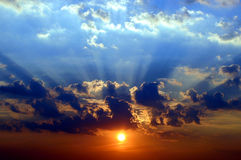 Dramatic Sunset. An impressive and dramatic sunset, with the rays of sunlight breaking through the clouds Stock Image