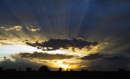 Dramatic sunset. Sun rays in the sky at dusk Stock Photo