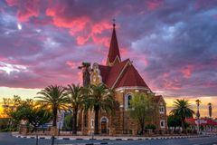 Dramatic sunset above Christchurch, Windhoek, Namibia. Dramatic sunset above Christchurch, a historic landmark and Lutheran church in Windhoek, capital city of royalty free stock image