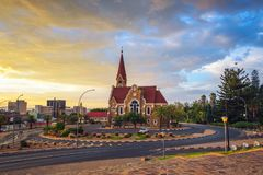 Dramatic sunset above Christchurch, Windhoek, Namibia. Dramatic sunset above Christchurch, a historic landmark and Lutheran church in Windhoek, capital city of royalty free stock images