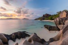 Dramatic sunset at Anse Source d`Argent beach, La Digue island, Seychelles Stock Photo