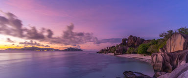 Dramatic sunset at Anse Source d`Argent beach, La Digue island, Seychelles Stock Images