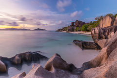 Dramatic sunset at Anse Source d`Argent beach, La Digue island, Seychelles Royalty Free Stock Images