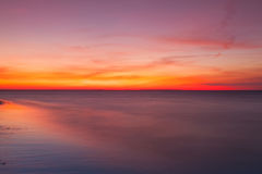 Dramatic sunset on the beach, Cape Cod, USA. Long exposure - Dramatic sunset on the empty beach, Cape Cod, USA royalty free stock photography