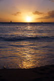 Dramatic Sunset from beach over ocean. Dramatic Sunset from Waikiki beach over ocean with boats sailing on the water on Oahu, Hawaii Stock Photography