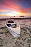 Dramatic Sunset and a Boat Stock Image