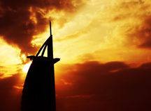 Dramatic sunset with building silhouette Stock Photo