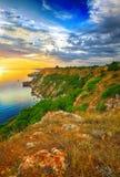 Dramatic sunset at cape fiolent. Crimea. Dramatic sunset at cape Fiolent with rocks and grass at foreground. Crimea Royalty Free Stock Photography