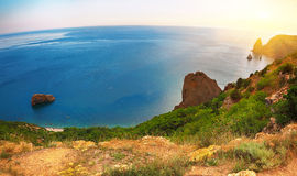 Dramatic sunset at cape fiolent. Crimea. Dramatic sunset at cape fiolent with rocks and grass at foreground. Panoramic view. Crimea Royalty Free Stock Photo