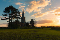 Dramatic sunset with church in Cambridgeshire Royalty Free Stock Photography