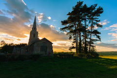 Dramatic sunset with church in Cambridgeshire Stock Photos