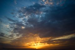 Dramatic sunset with clouds. Nature summer light Royalty Free Stock Images