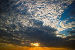 Dramatic sunset with clouds. Nature summer light Stock Photography