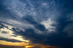Dramatic sunset with clouds. Nature summer light Stock Photo
