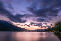 Dramatic sunset cloudscape over mountain lake. Cold and warm gradient Stock Image