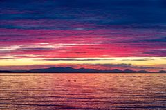 Free Dramatic Sunset Colors Over Birch Bay USA Royalty Free Stock Photography - 101147597