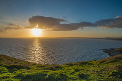 Dramatic sunset on Cornish coast , over Atlantic Ocean Royalty Free Stock Images