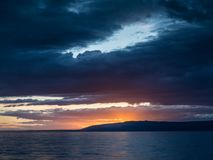 Dramatic sunset with dark clouds in Istria stock photo