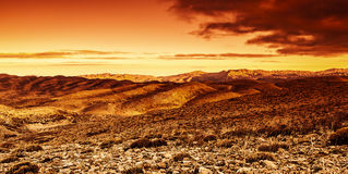 Dramatic sunset in desert Stock Photography
