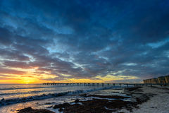 Dramatic sunset at Glenelg Beach Stock Images