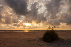 Dramatic sunset with heavy clouds over Baltic. Royalty Free Stock Image