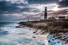 Dramatic sunset with iconic lighthouse on coast Royalty Free Stock Photos