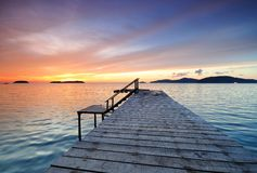 Dramatic sunset by the jetty Stock Photography