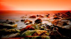 Dramatic sunset on lake stock image