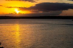 Dramatic sunset on the lake. Fall of the sun in Tibau do sul. Nature in the south of Natal. Dramatic sunset on the lake. Fall of the sun in Tibau do sul. Nature stock photo