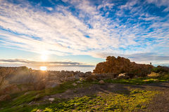 Dramatic sunset with lens flares above the sea Stock Photo