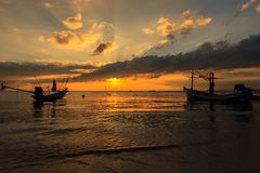 Dramatic Sunset with local boat Royalty Free Stock Photo