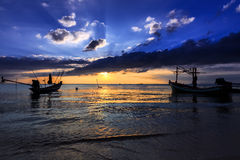 Dramatic Sunset with local boat in Thailand Royalty Free Stock Images